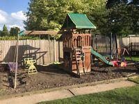 Kids climbing frame swing and slide garden