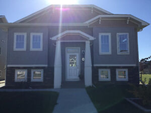 Sylvan Lake Custom Home with Legal Suite