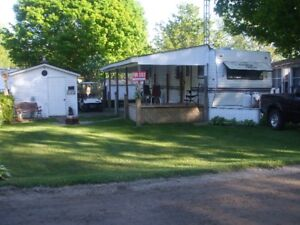 Country Charm trailer on a 40X60 foot lot