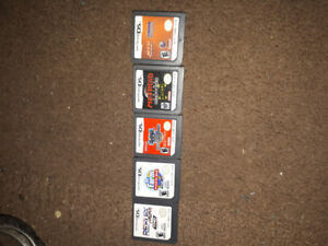 Nitendo Ds , charger, case and 5 Games