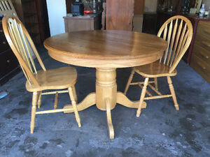 Round Pedestal Table and 2 Chairs.