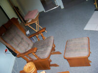 Two sieder chairs with sliding footstools