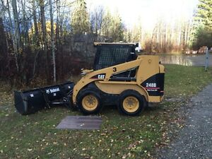 Cat Skid Steer with snow plow