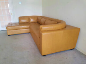"""High end """"Buffalo"""" leather sectional couch, valued over $8000"""