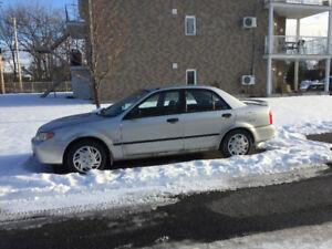Mazda protegé 2002 automatic $1200 negotiable