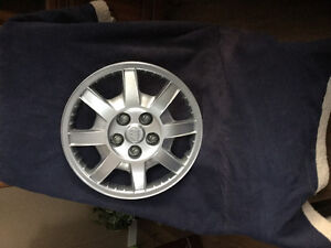 Four 17 inch Hubcaps
