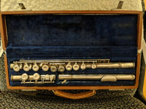 Flute with sheet music for sale - ideal for beginner.