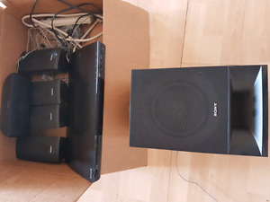 Sony sround system with 5 speakers and DVD plz text 7807165653