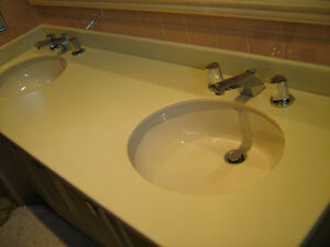 Counter, corian with 2 sinks and faucets