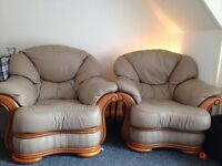 Pair of beige leather arm chairs £40 ono