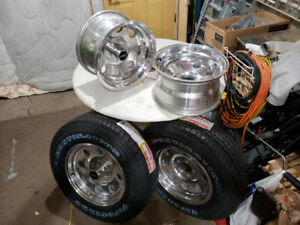 15 X 8 and 15 X 7 Eagle Alloy Wheels With Two  New Tires $500.00