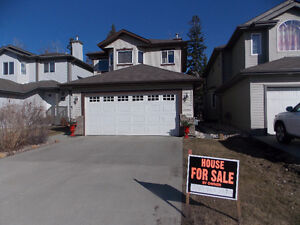 Fully Finished home in Macewan Community backing onto trees