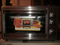 New unused Hamilton Beach Countertop Oven with Rotisserie