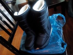 Brand new, lady's boots, waterproof, $25
