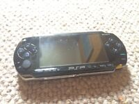 Sony PSP with charger and games