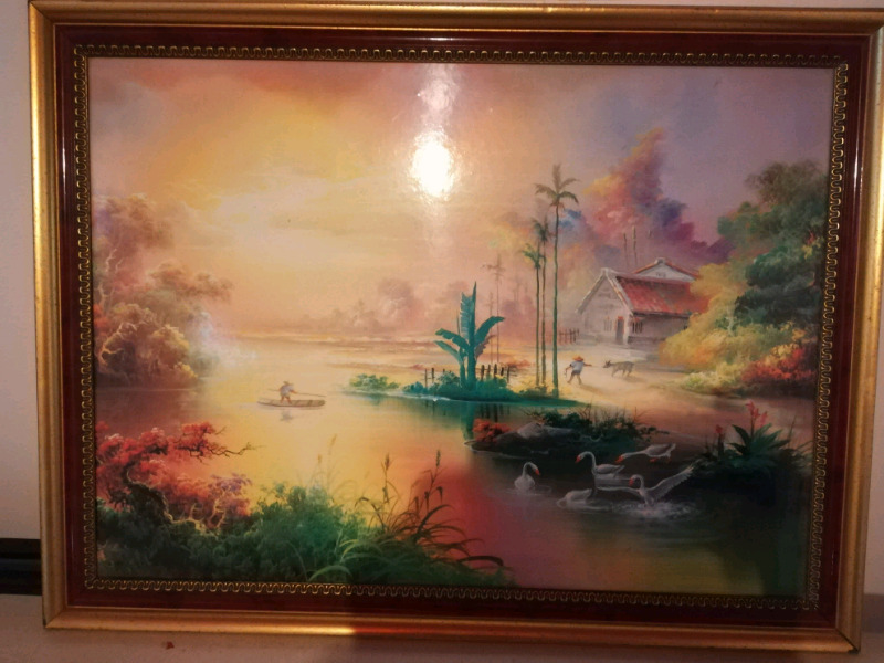 Painting in gold frame