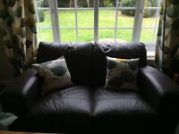 DFS matching 3 seater sofa, 2 seater sofa, and footstool. Dark brown leather.