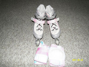 Girl roller blades pads included like new