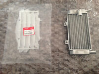 NEW HONDA OEM LEFT radiator and grill for crf250