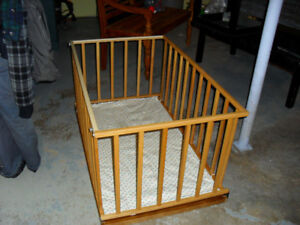 wooden crib and playpen