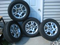 Four Dodge Carvan alloy rims with Michelin Hydroedge (215/65R16)
