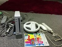 Wii console and sing it the game