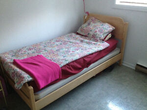 Twin bed frame with box spring and mattress