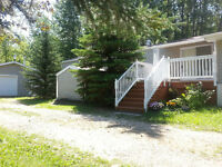 Acreage with 1309 sq.ft. home on Gull Lake