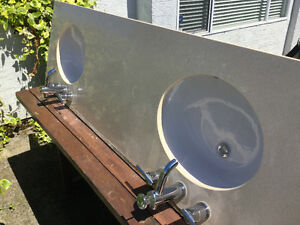 Bathroom corrian  counter top and double sinks/faucets