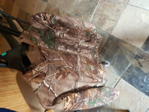 NEW NEVER WORN SPRING CAMO COAT. MENS SMALL OR KIDS XL.