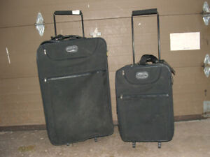 REDUCED suit cases