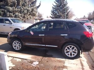2011 Rogue SV AWD . Heated seats.  Remote