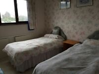 2 Pink floral matching single bed sets and curtains