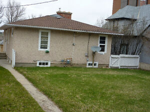 Close to downtown, 2 + 1 BR, 1.5 bath, fenced yard, parking in