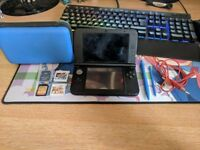 Nintendo 3DS XL with games (Pokemon Y and Super Smash Bros) and accessories