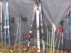 Cross country and down hill skis and 2  pair boots and poles