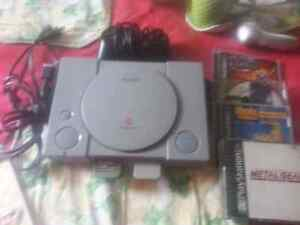Ps1 with all cords one controller and four games