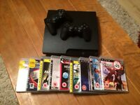 PS3 150GB console, 2 controllers and 8 games