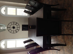 Beautiful solid maple dining table with eight high back chairs