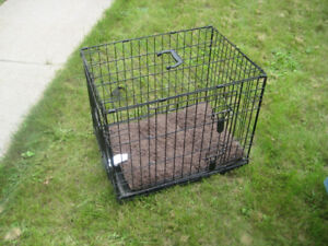 dog cage Med size , two doors like new