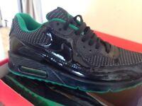 Black and green Nike air Max's