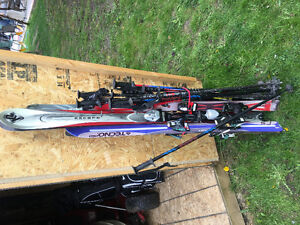 4 Pairs of Old Skis and Poles