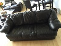 MUST GO: Black leather couch
