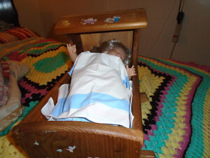 doll and cradle