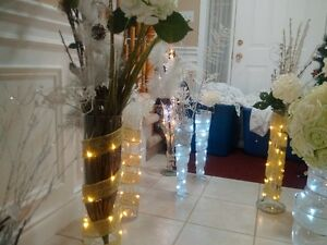 large glass vases with ribbon lights