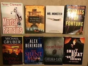 A box of 8 assorted hard cover books for sale