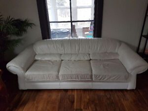 White leather couch and chair
