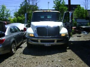 2010  FLAT BED ROLL BACK TOW TRUCK