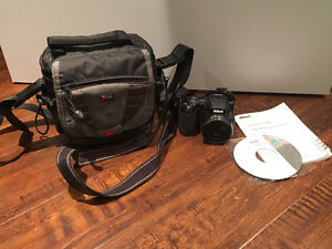Nikon Coolpix L120 with Camera Bag & User Manuals, Barely Used!