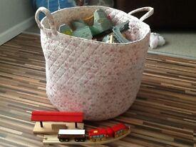 Bucket of wooden Brio train set